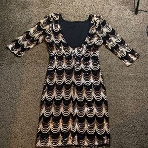 Sequin party dress with 3/4 sleeves and low back